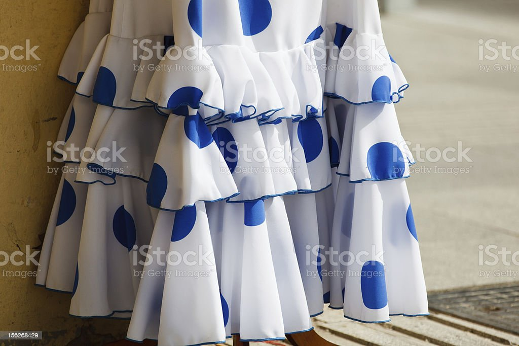 Ruffles Hemline of white flamenco dancer dress with blue pokadots. royalty-free stock photo