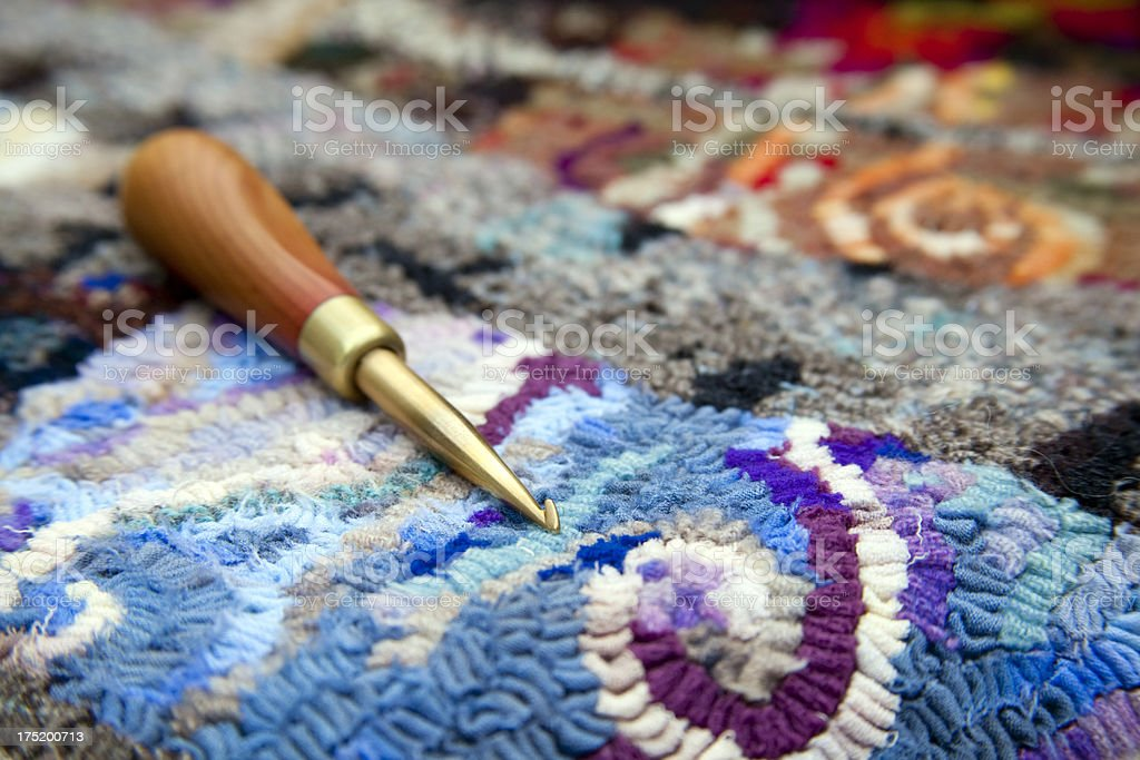 Rug Hook on a Traditional Hooked Mat stock photo