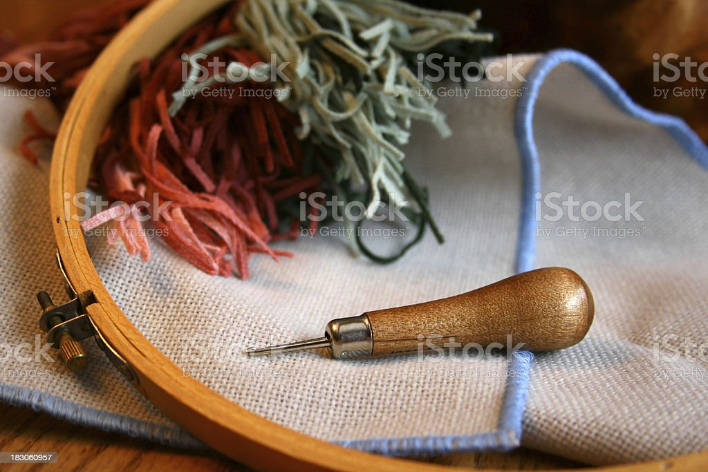 Rug Hooking Hook and Burlap an Early American Folk Art royalty-free stock photo