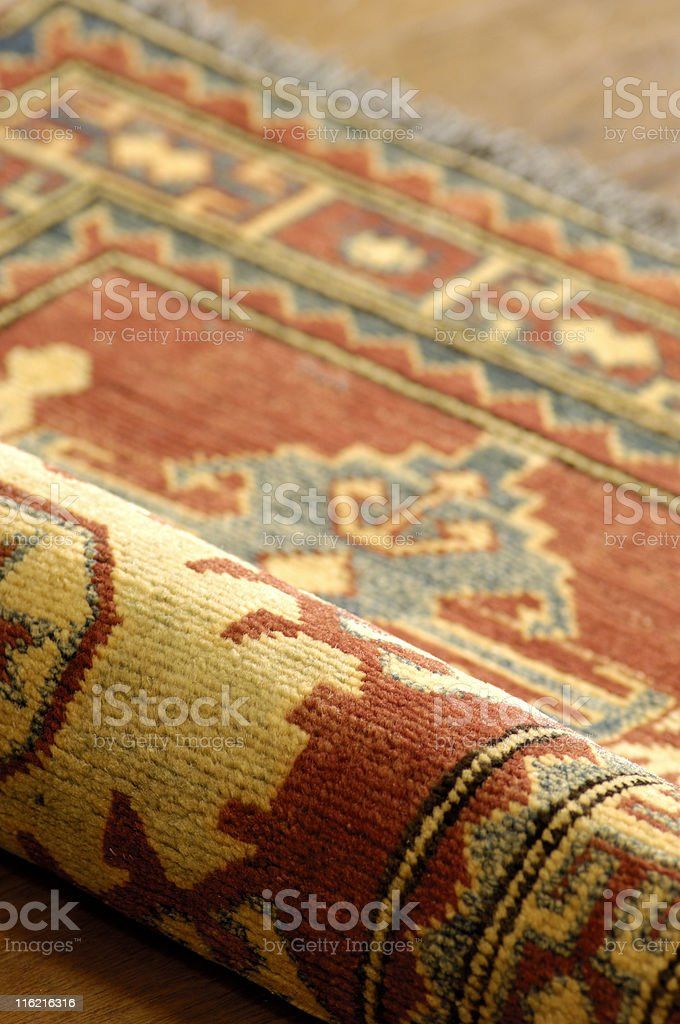 Rug on wooden floor royalty-free stock photo