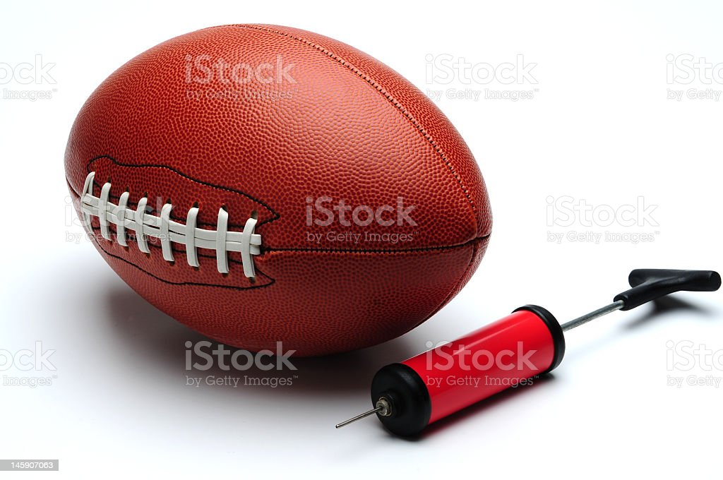 Rugby Ball and pump stock photo