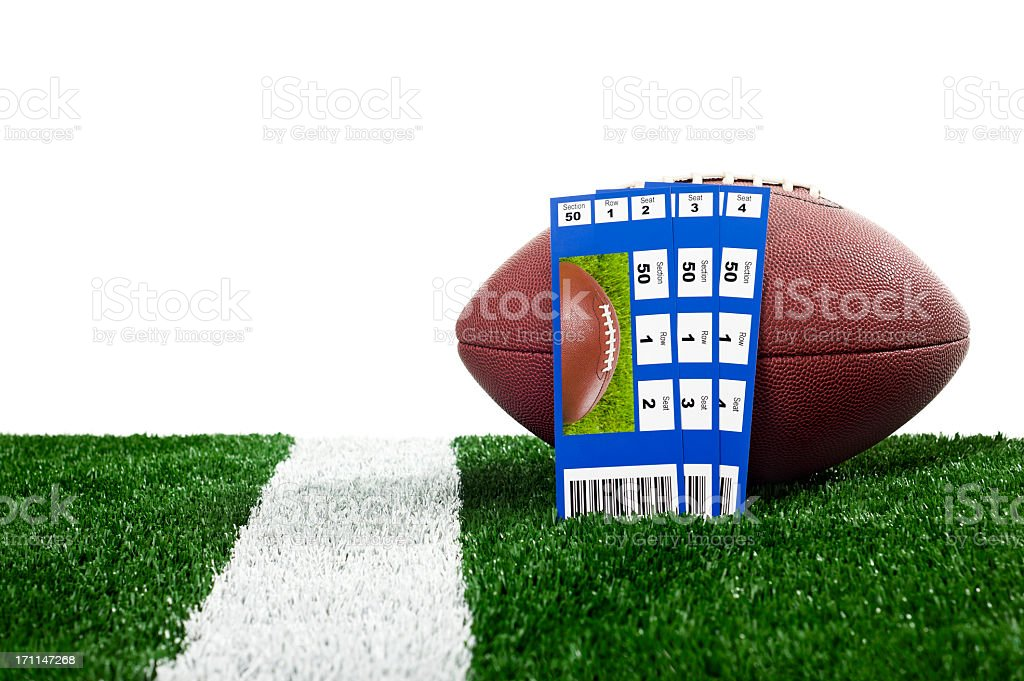 A rugby ball and three game tickets royalty-free stock photo