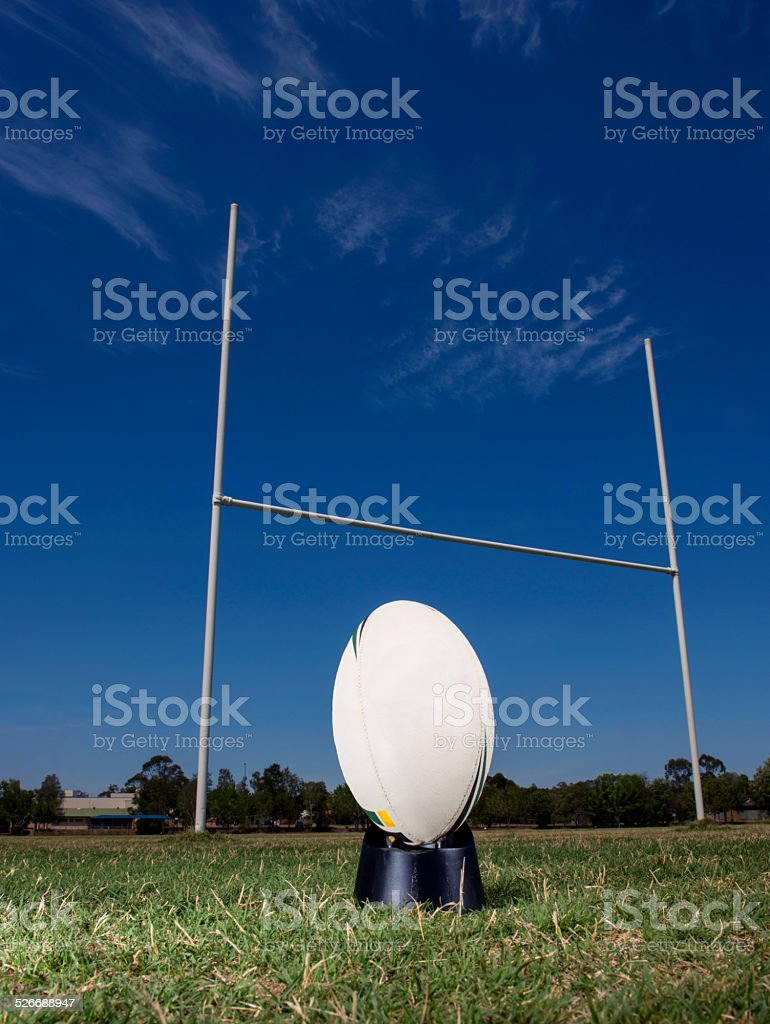 Rugby ball in front of goal posts. stock photo