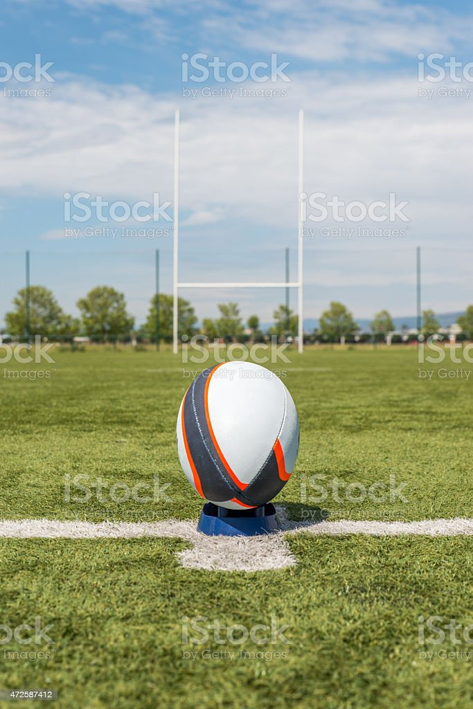 rugby ball in front of the pole. stock photo
