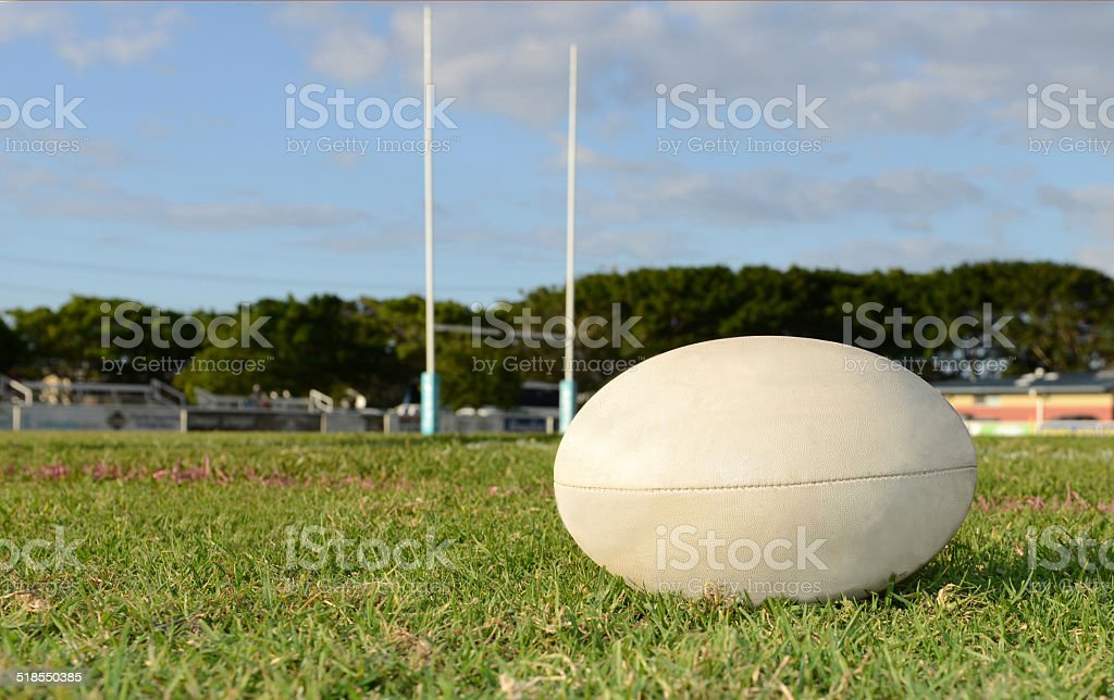 Rugby Ball on a sporting field stock photo