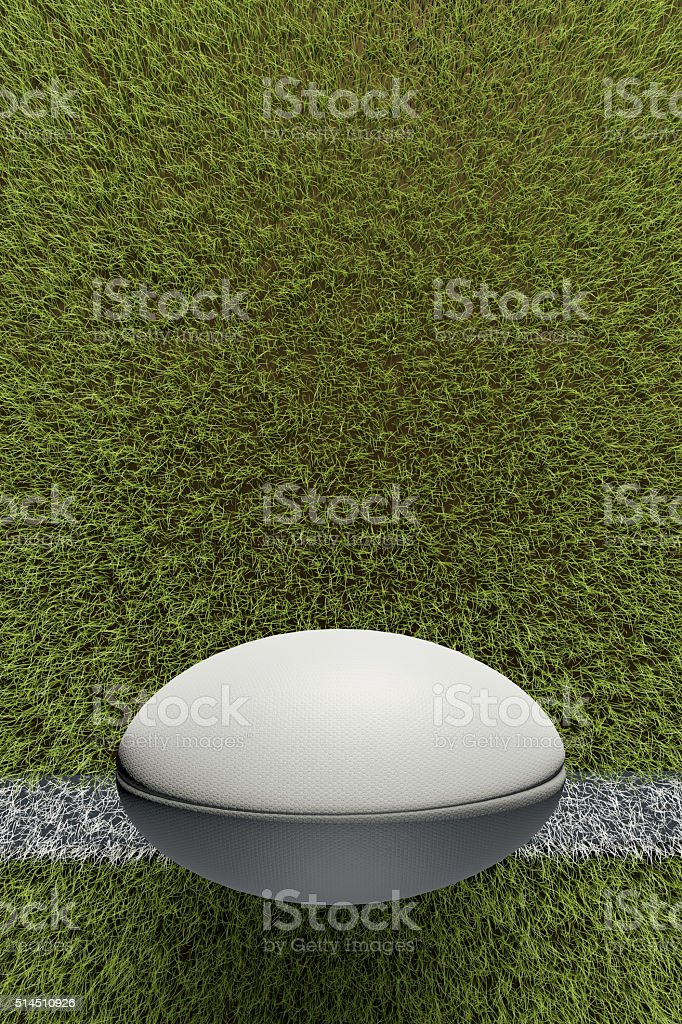 Rugby ball on grass pitch stock photo