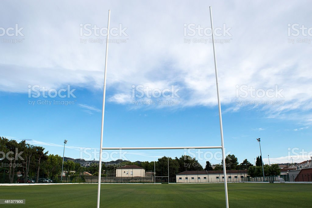 Rugby goal posts with green field stock photo