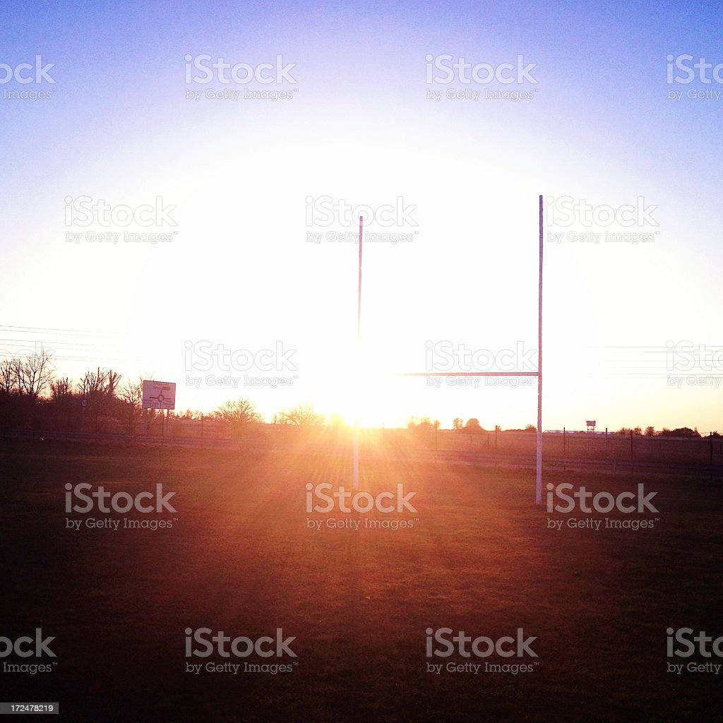 Rugby goalposts with the sun setting stock photo