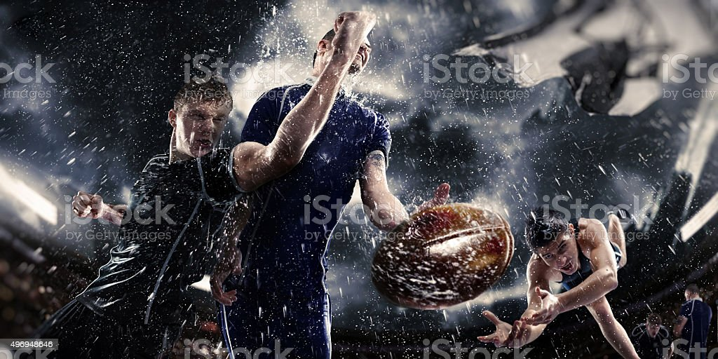 rugby in the rain stock photo
