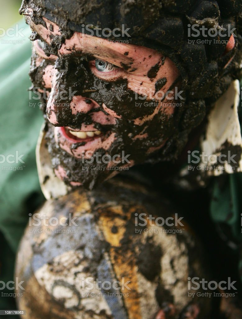 Rugby Player Covered in Mud royalty-free stock photo