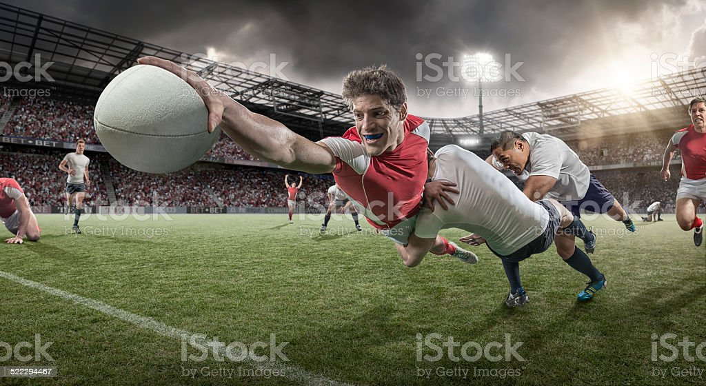Rugby Player Dives to Score stock photo