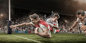 Rugby Player Dives to Score Whilst Being Tackled