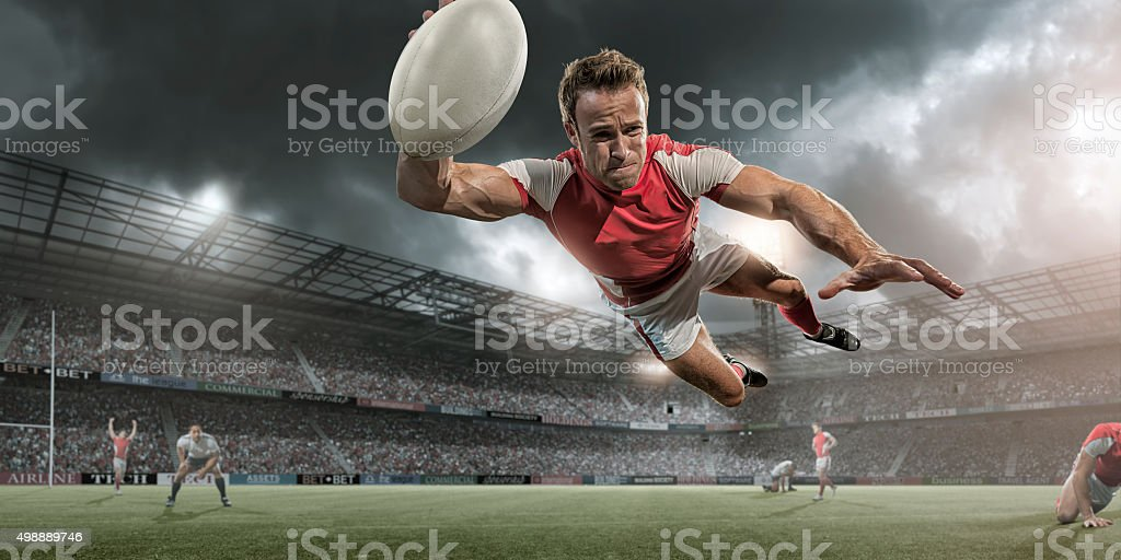Rugby Player Diving in Mid Air About To Score stock photo