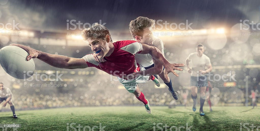 Rugby Player Diving To Score During Tackle in Rugby Game stock photo