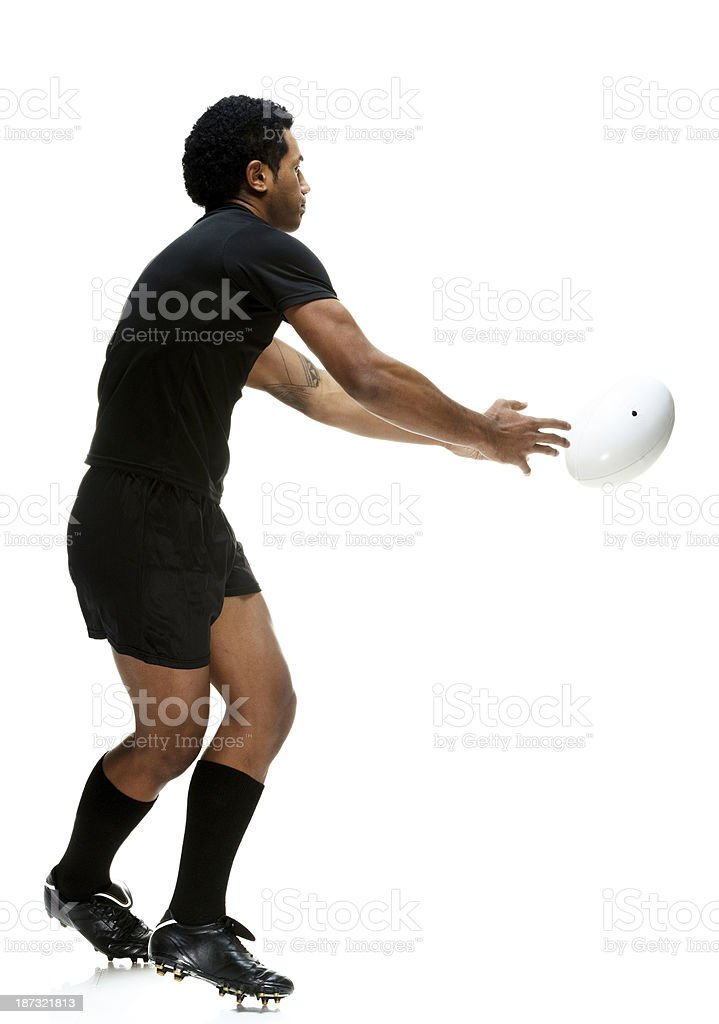 Rugby player in a white background royalty-free stock photo