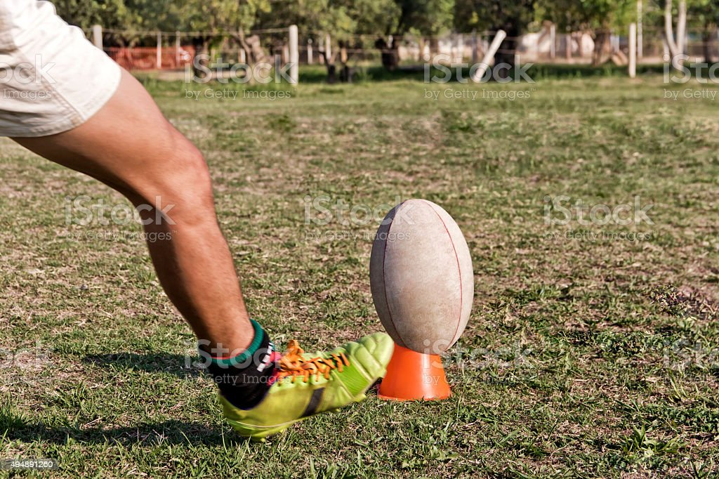 Rugby player in goal kick stock photo