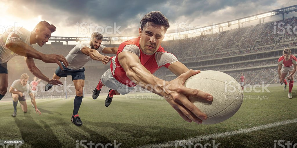 Rugby Player In Mid Air Dive About To Score stock photo