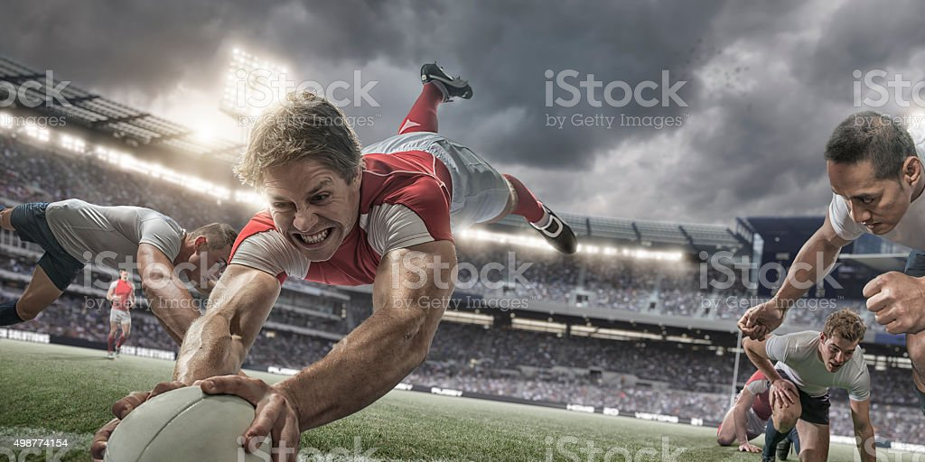 Rugby Player in Mid Air Scores with Heroic Dive stock photo