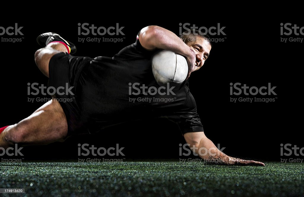 Rugby player isolated on black. royalty-free stock photo