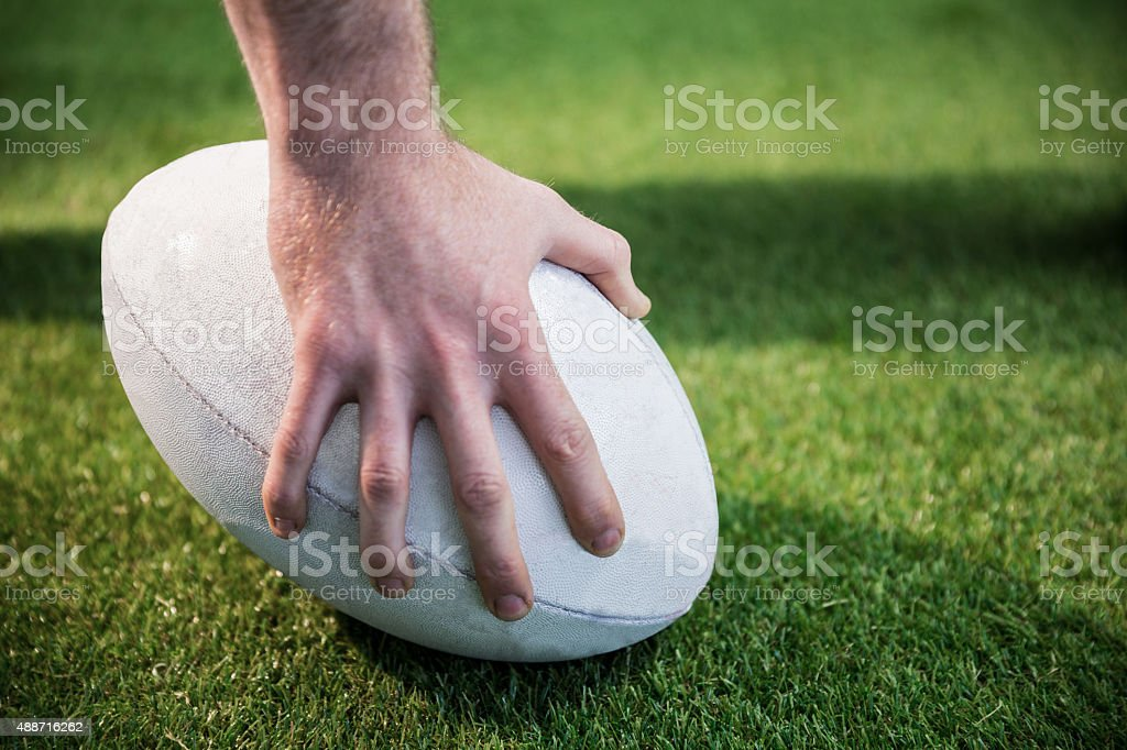 Rugby player posing a rugby ball stock photo