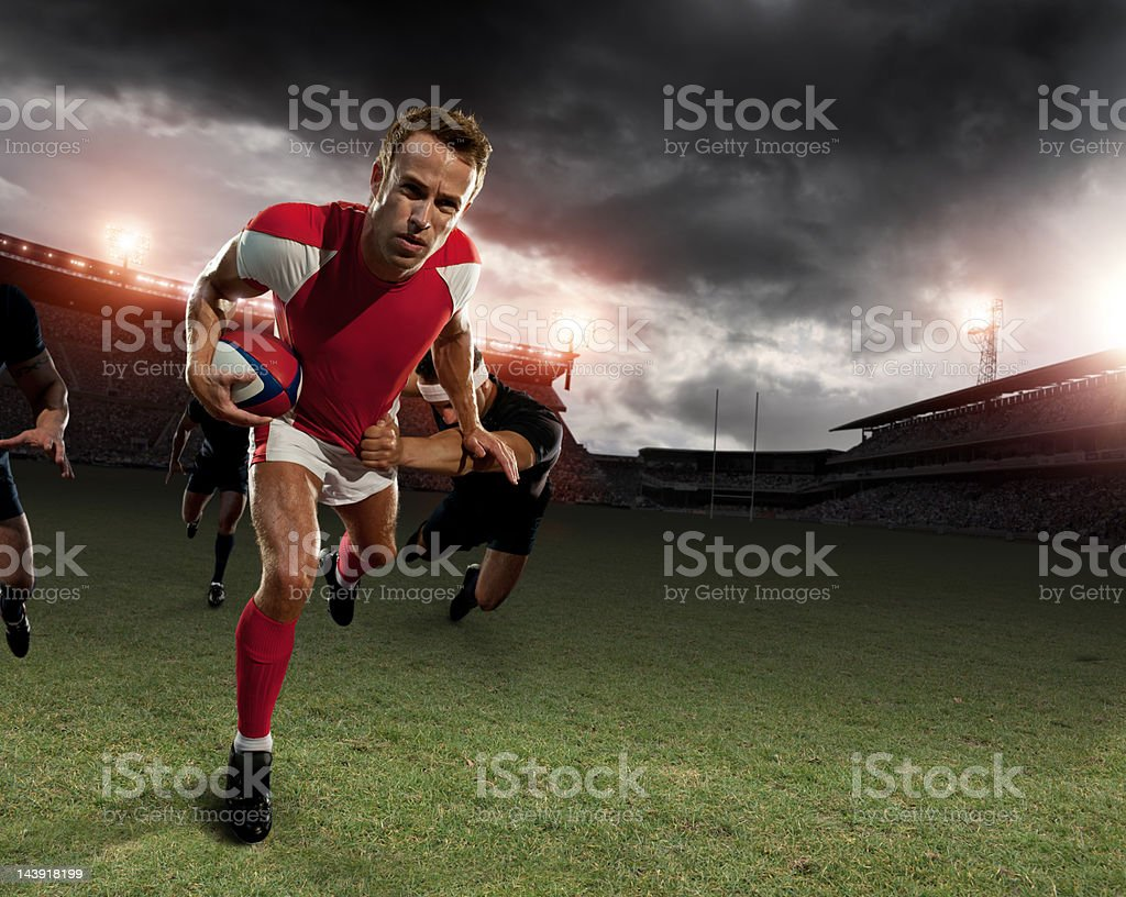 Rugby Player Running with Ball royalty-free stock photo
