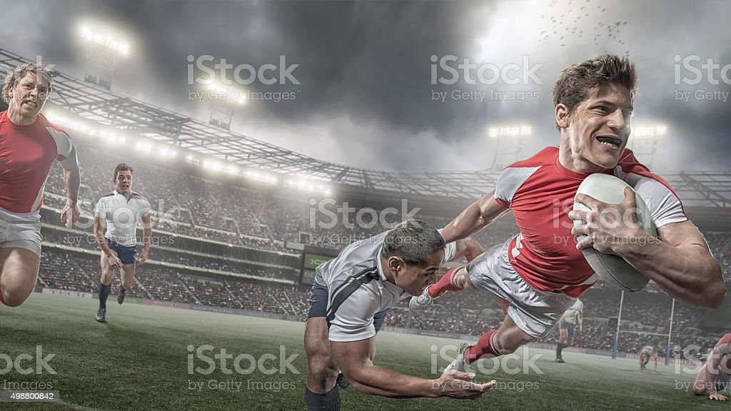 Rugby Player Scores in Heroic Dive During Rugby Game stock photo
