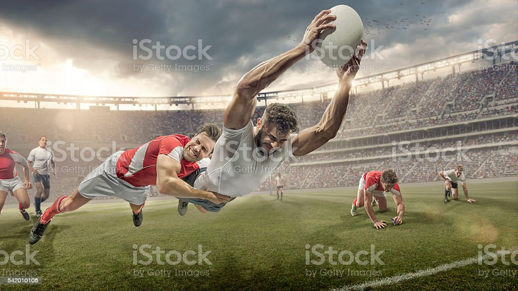 Rugby Player Tackled in Mid Air Dives To Score stock photo