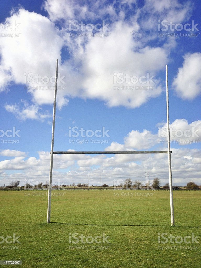 Rugby post against blue sky stock photo