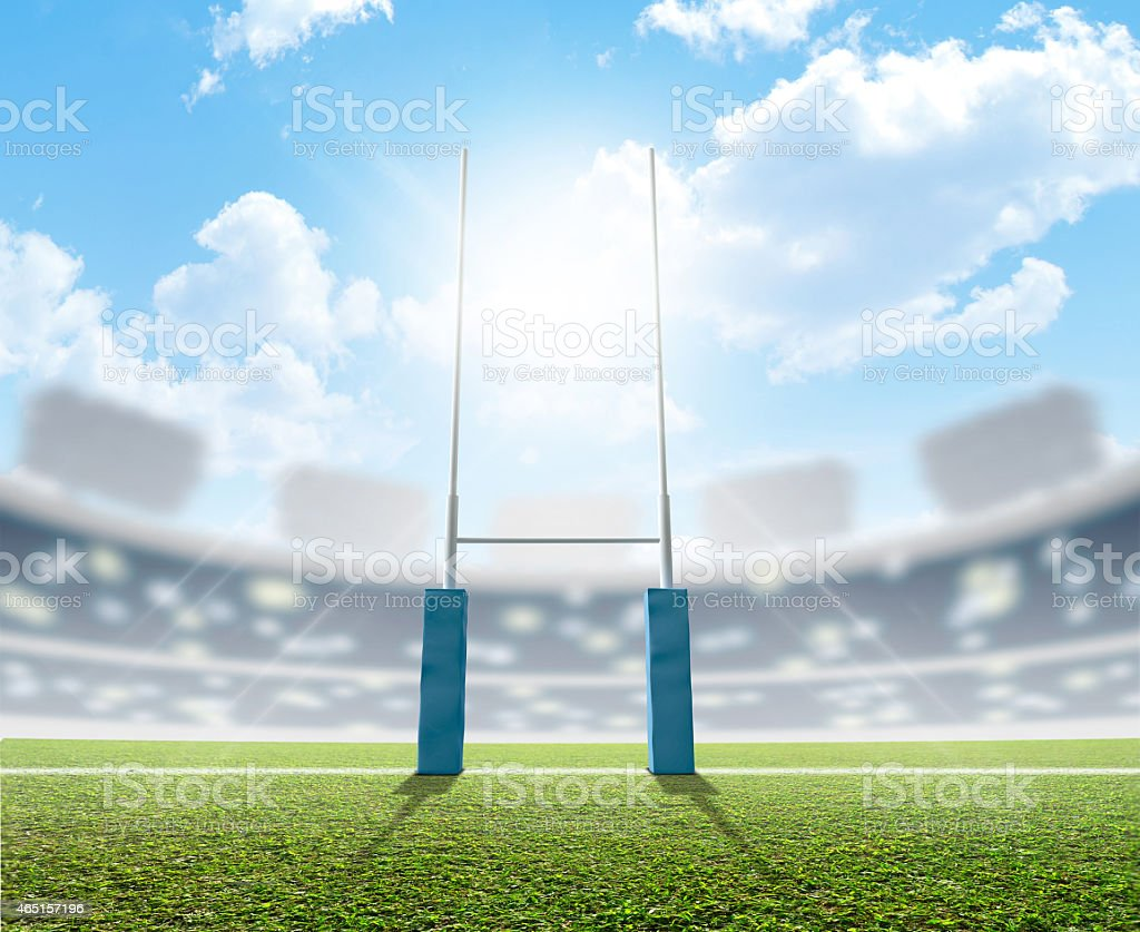 Rugby posts in a bright sunny stadium stock photo