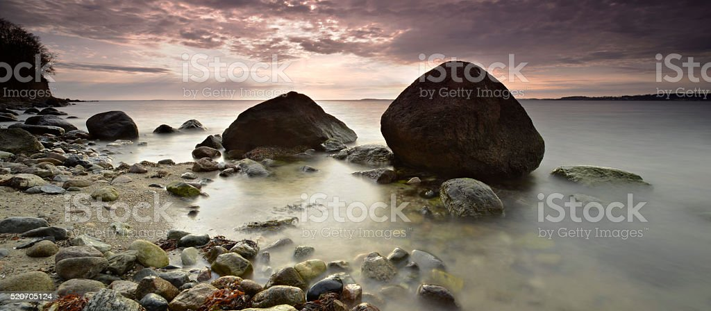 Rugen Island Seascape with Huge Boulders under Dramatic Cloudy Sky stock photo