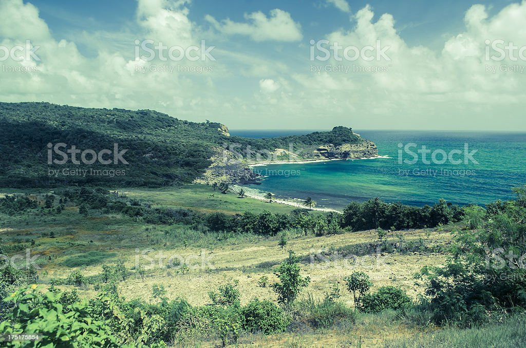 rugged arid coastal landscape with ocean and sky royalty-free stock photo