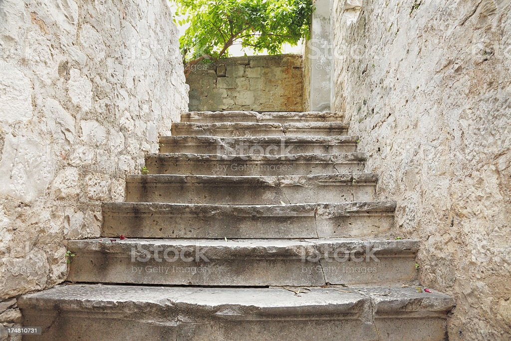 rugged city cobblestone alley with stairs Croatia royalty-free stock photo