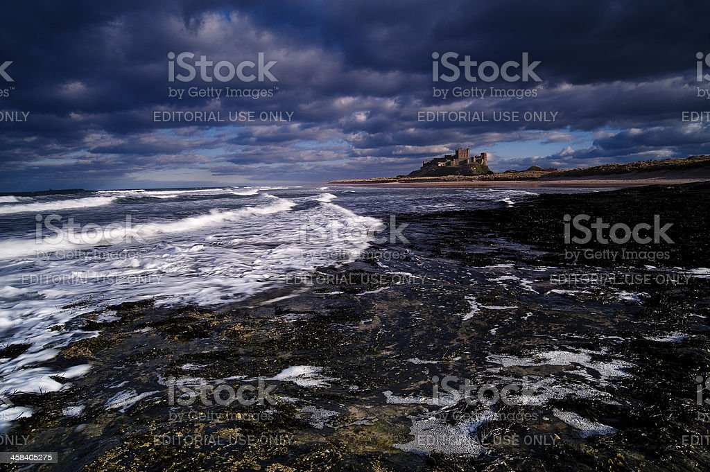 Rugged coast line at Bamburgh Castle, Northumberland, England stock photo