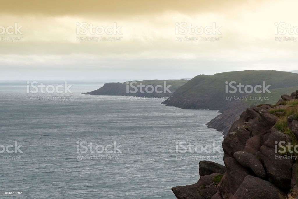 rugged coastline with clouds above stock photo
