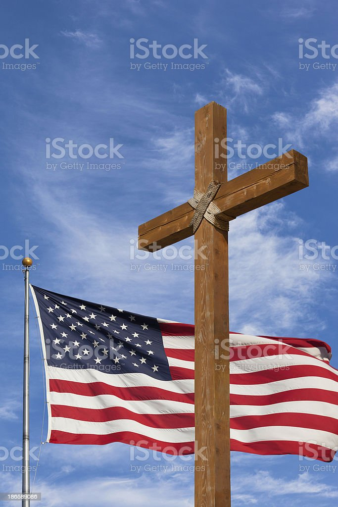 Rugged cross and American Flag royalty-free stock photo