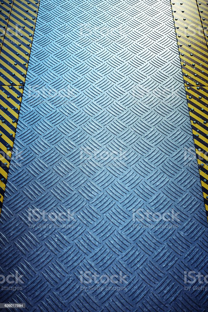Rugged Industrial Catwalk With Danger Stripes stock photo