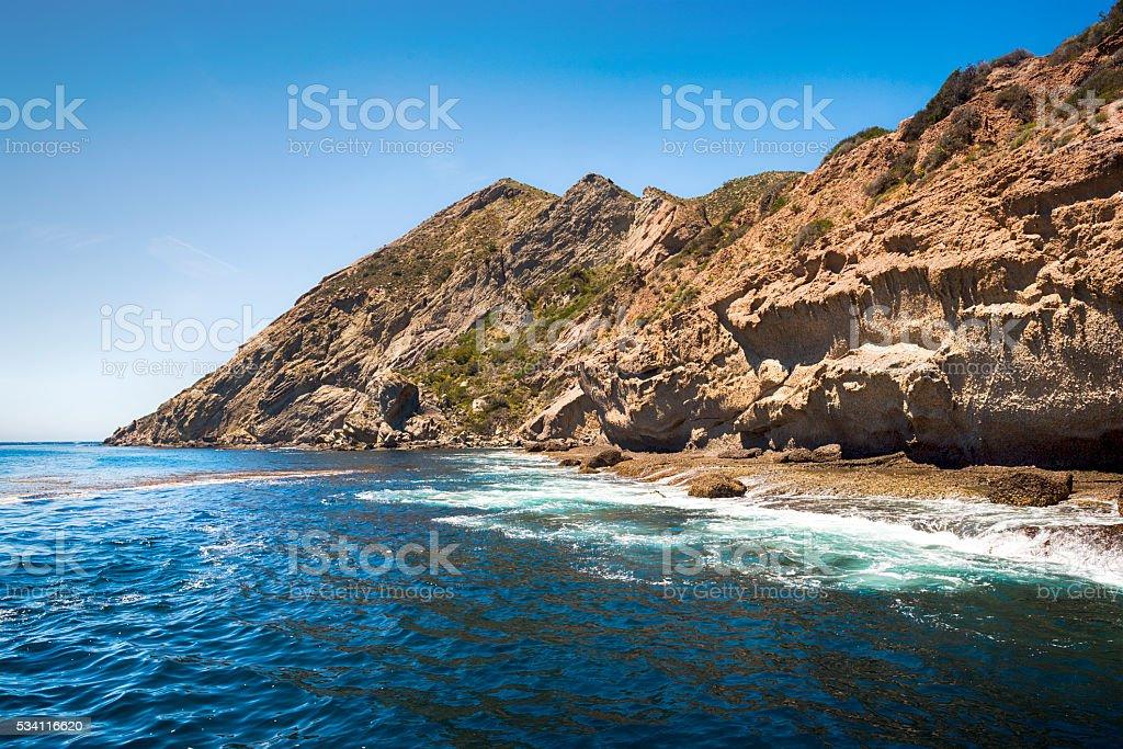 Rugged island shoreline stock photo