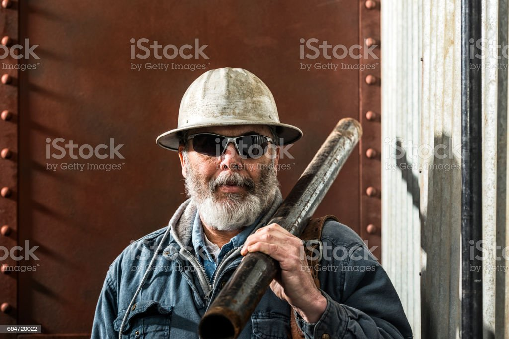 Rugged looking Middle-aged construction worker on job site stock photo