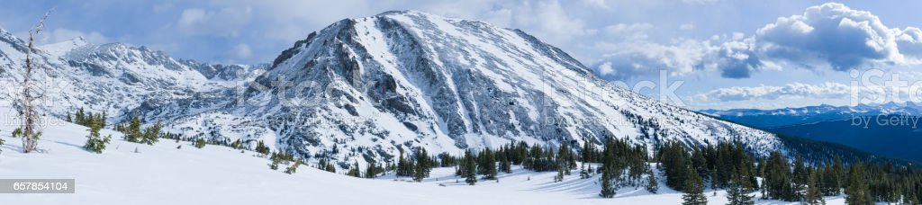 Rugged Mountains Winter Panorama stock photo