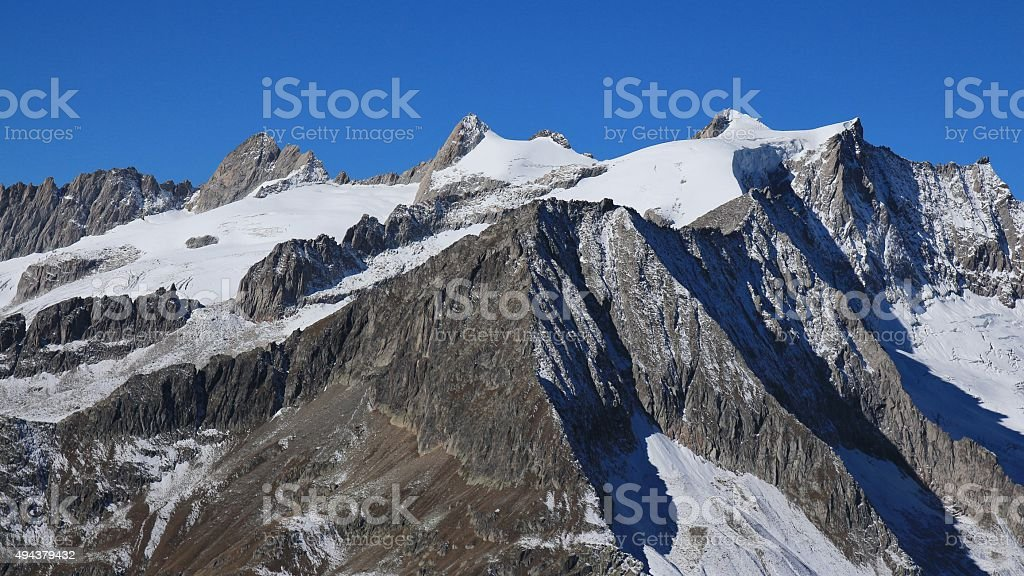 Rugged Mt Geisshorn and glacier stock photo