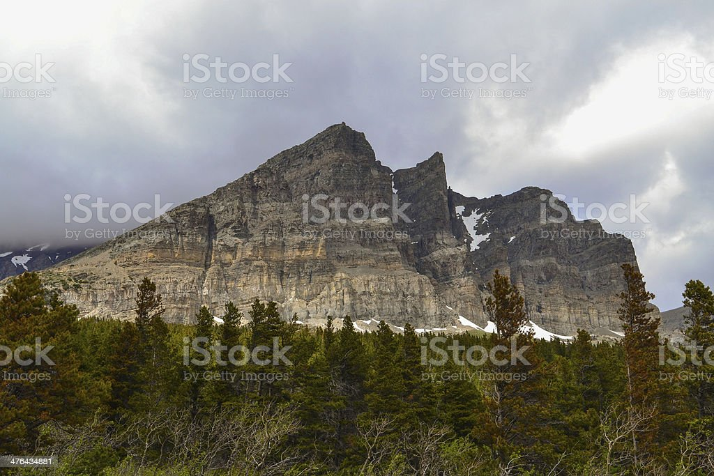 Rugged peak with forest stock photo