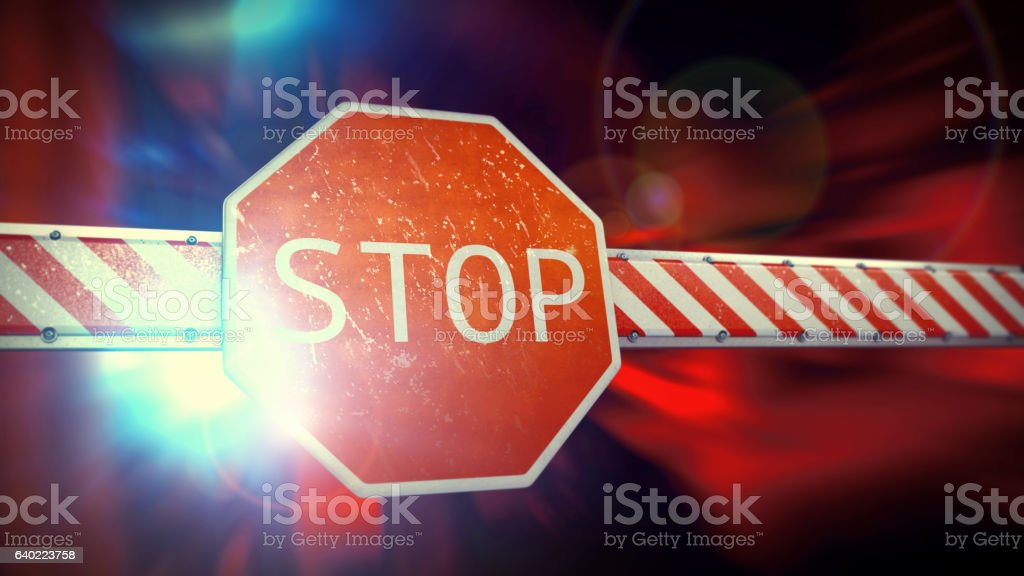 Rugged Security Barrier With Stop Sign In A Dynamic Environment stock photo