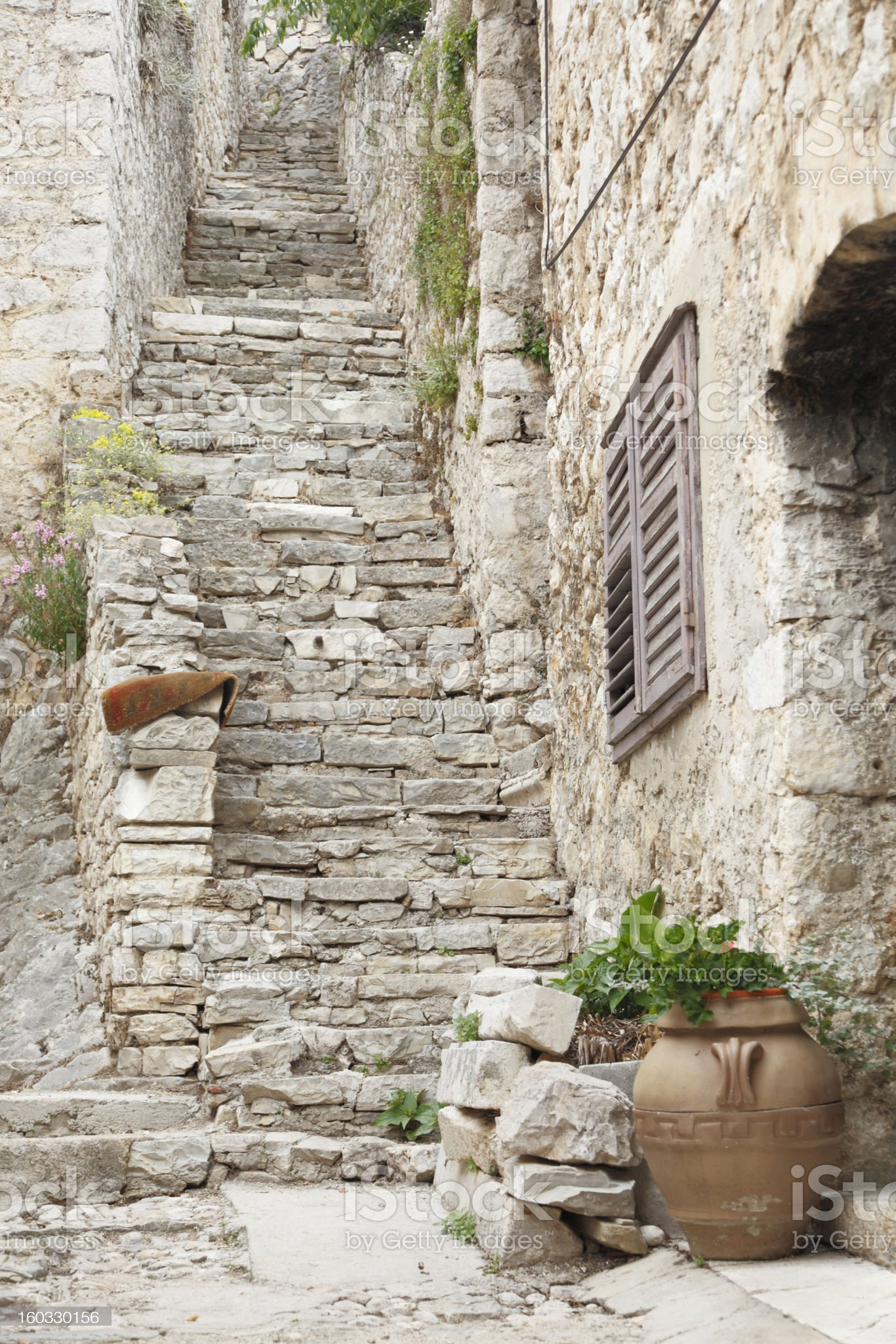 rugged village cobblestone alley with stairs Croatia royalty-free stock photo
