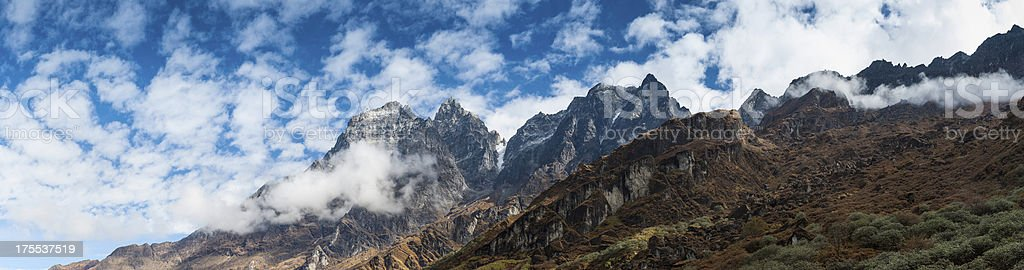 Rugged wilderness peaks dramatic mountain panorama stock photo