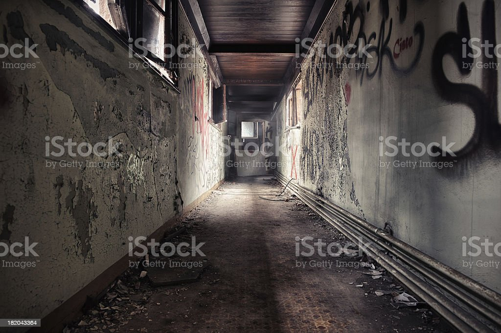 Ruin corridor with leaking sunlight HDR stock photo