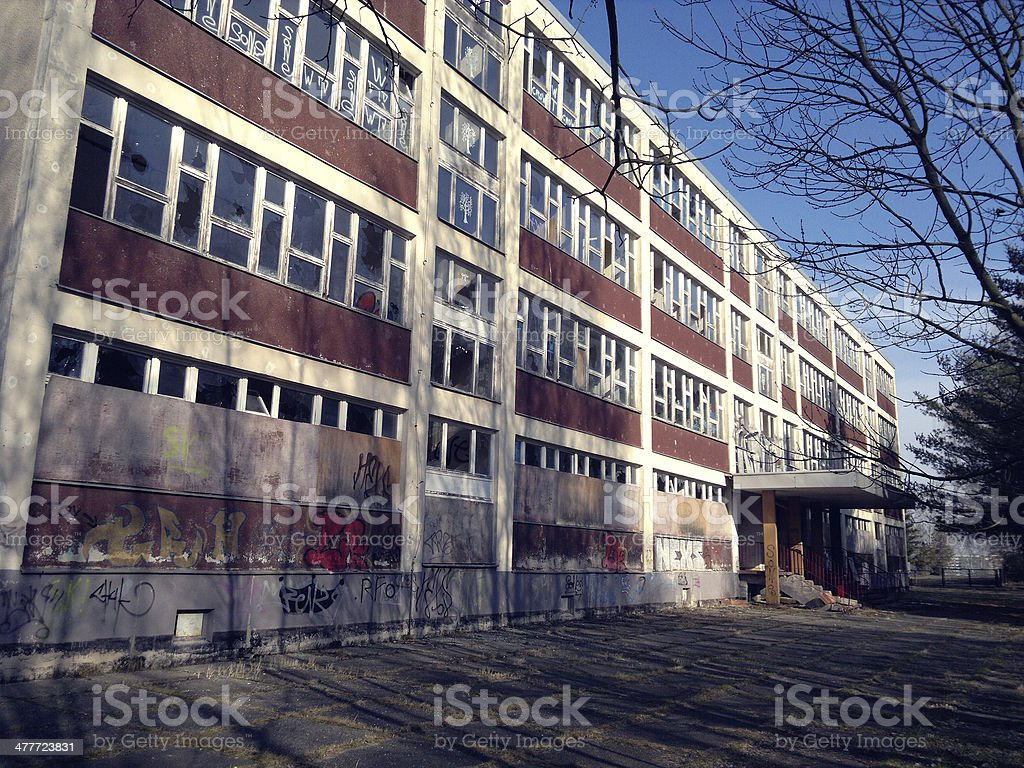 Ruin of an old school in GDR style stock photo
