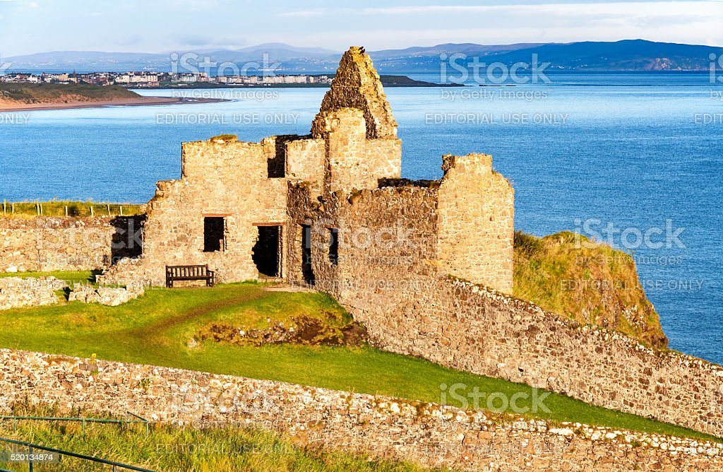 Ruin of Dunluce castle and Portrush in Northern Ireland stock photo