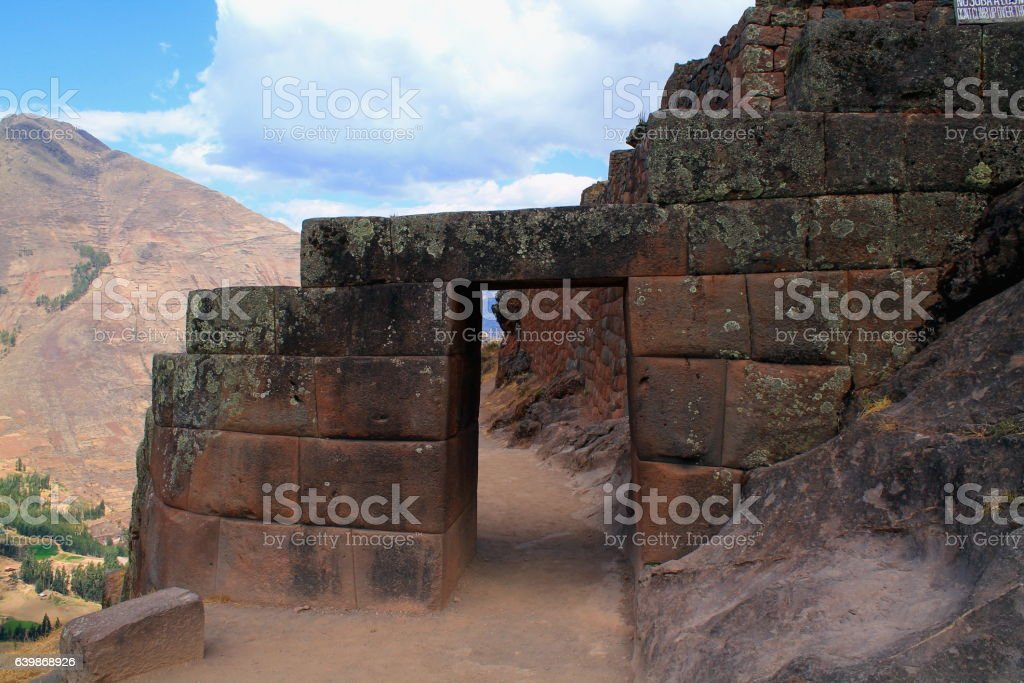 ruin with door and mountain panorama at pisaq stock photo