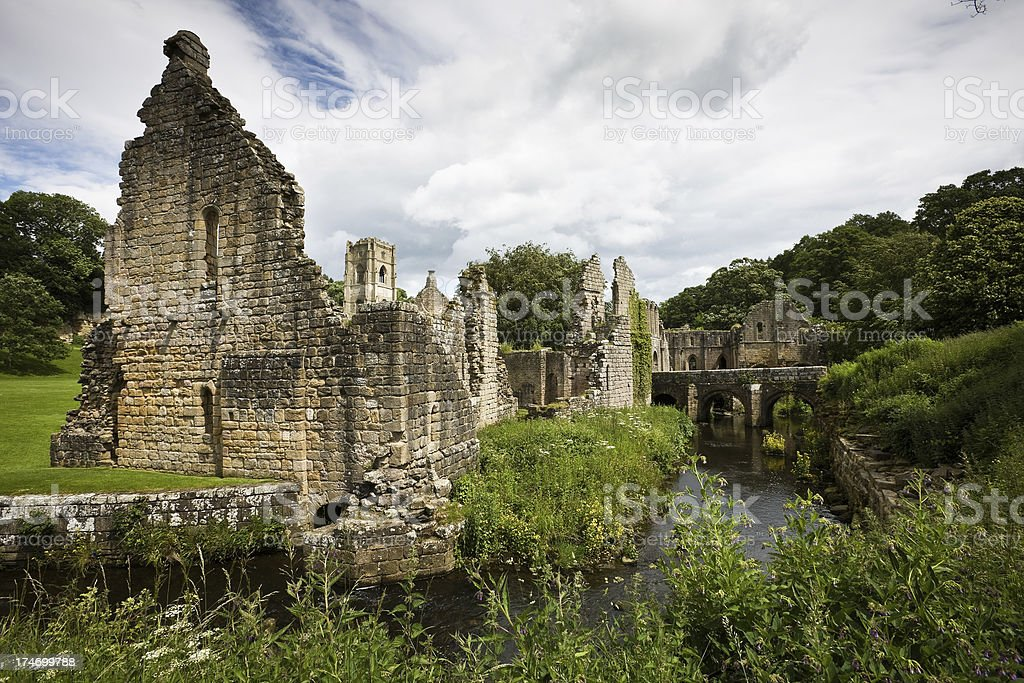 Ruined Abbey and River in Yorkshire stock photo