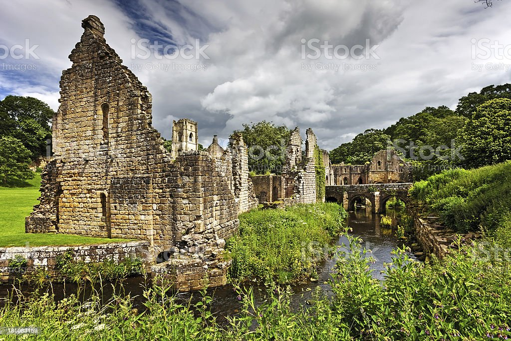 Ruined Abbey and River in Yorkshire royalty-free stock photo